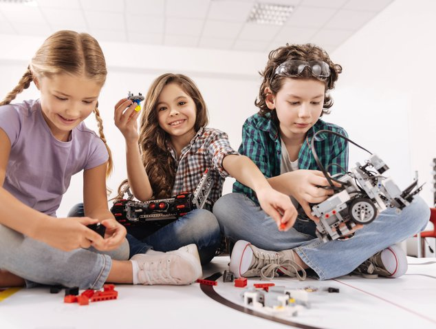 Children playing with Mars Rover Model